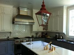 red pendant lamp - love the lamp -- maybe not in red for my kitchen