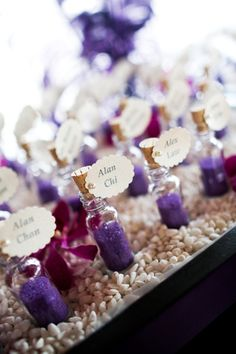 bottles with purple sand for escort cards