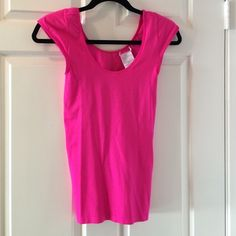Hot pink Shirt  Super super comfy and material is almost as wearing spanx. Love them, have them in every color. BCBGMaxAzria Tops