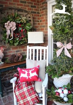A Farmhouse Christmas-from The Everyday Home Tobacco Basket on Front Porch with Magnolia Wreath