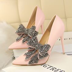 Bigtree | Spring/Summer 2018 | Rhinestone-embellished Pumps in pink polyurethane (PU), featuring large detachable black-rhinestone-encrusted double bows on the vamps, sharply pointed toes, slip-on styling and very high wrapped stiletto heels | from AliExpress.com | May 2018