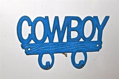 Cowboy Wall Hook/ Bright Blue/ Country/ Western Theme Distressed Cast Iron Hanger/ Painted/ Boys Room Decor. $19.99, via Etsy.