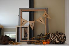 Fall mantle decor.  Old frames are easy to find at garage sales and the salvation army.  I found these at a flea market and used them as they were for an easy mantle display.