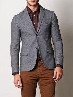 Grey blazer with brown shirt and pants.