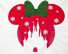 Theres no place like home for the holidays, and this beautiful shirt is the perfect addition to your wardrobe for this most magical season. An iconic Minnie Mouse head shape with a glittering red bow, silver belt and glitter holly accent. Add a name in the classic Disney font to make your trip home to Disney World or Disneyland for the Christmas season complete. Ask about family shirts for the perfect holiday picture or to wear to Mickeys Very Merry Christmas Party in the Magic Kingdom…