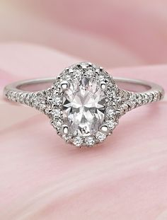 This dazzling antique halo diamond ring is stunning.