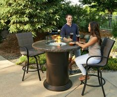 Bar Fire Pit: Raised fire pits can double as a bar for sitting. They also come with burner covers when you don't want a flame. http://www.longislandhottub.com/longisland_hot_tub_spa_blog/?p=1775