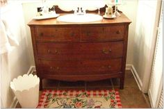 Love the idea of turning an old dresser into a bathroom vanity...run across dressers *cheap* at local auctions allll the time!!
