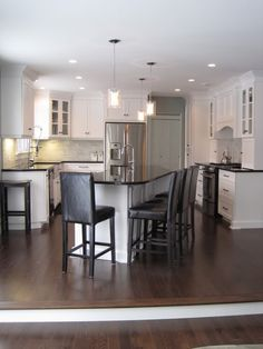 Working with existing black granite countertops and painting cabinets white = awesomest frugalness!