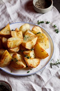 Crunchy, golden exterior giving way to fluffy, soft interior flavoured with thyme and rosemary infused salt. That is what you get when you eat these potatoes. And honestly, nothing more needs to be said so I won't even try to wax lyrical about it. Just make these, eat them and then come back t…