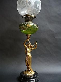 Good Art Nouveau gilt-metal and glass font figural kerosene lamp, signed Bruchon