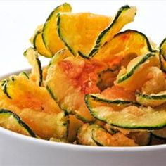 Baked Zucchini Chips with Paprika and Sea Salt - Cut a zucchini into thin slices and toss in 1 Tbsp olive oil, sea salt, and pepper. Sprinkle with paprika and bake at 450°F for 25 to 30 minutes.