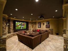 Cheer on your favorite team all football season in this comfy stone-columned TV room.