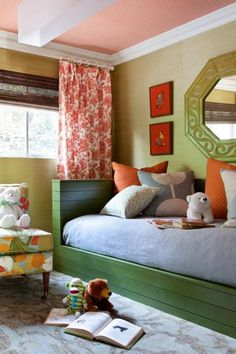 How sweet is this kid's bedroom blending bright orange and a soft green? Orange is such a bright energizing color, bringing harmony and energy to any space you use it in, perfect for a children's room. Learn how to incorporate orange into your home decor, in your living room, bedroom, kids bedroom, kitchen, dining room, bathroom, foyer, and other space. We also share popular combinations like orange and white, orange and blue, orange and gray. Hadley Court Interior Design blog.