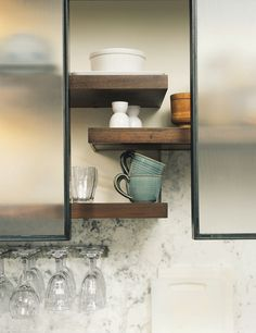 i'm thinking: open shelving with sliding frosted glass doors?  or sanded acrylic/plexiglass, to keep the cost and weight down (and much safer if things got banged around!)