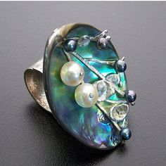 I am going to start reposting some of my older pieces. Abalone, pearls and Argentium Silver ring. #metalsmith #silversmith  #handmade #handmadejewelry #jewelry #jewellery #jewleryporn #instasmithy #rings