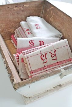 wooden box with beautiful folded linens