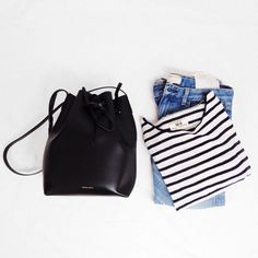 Mansur Gavriel bucket bag, blue jeans, and a striped tee.
