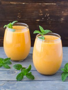 This vibrant orange Mango Carrot Smoothie has a healthy glow and you can too! It only takes 4 ingredients and a few minutes and it's packed with nutrition!