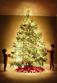Children hanging ornaments on the tree Toni Kami Joyeux Noël  Sherry Conrad Christmas Photography