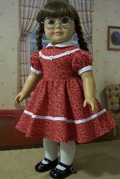 White tights and black Mary Jane shoes. Flared skirting with white trim. White trim on bodice and heart shaped buttons. Puffy short sleeves with white trims. Knitting Dolls Clothes, Ag Doll Clothes, Crochet Doll Clothes, Doll Clothes Patterns, Doll Patterns, American Girl Doll Molly, American Girl Dress, American Girl Clothes, American Dolls