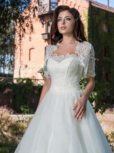 Timeless A-line style wedding dress with a bold lace bodice and full tulle skirt. Comes with an elegant lace bolero to give it that classic vintage feel. Lace Bolero, Lace Bodice, Elegant Bride, Exclusive Collection, Wedding Inspiration, Wedding Ideas, Wedding Gowns, Tulle, Romantic