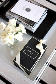 Homevialaura | coffee table books | Jo Malone | scented candle | white roses | striped carpet | Balmuir Kensington leather tray | Hay Tray table