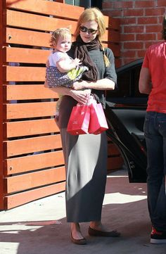 Nicole Kidman carried her youngest daughter, Faith, to a birthday party in LA.