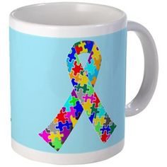 $14 Autism Ribbon Mug on a pretty blue background. A great gift for autistic awareness for children. Different colored puzzle pieces make up the ribbon.