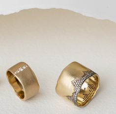 Chic, wide gold bands dripping in diamonds