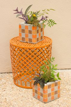 A little paint turns a half cinder-block into an attractive planter! via Design Improvised