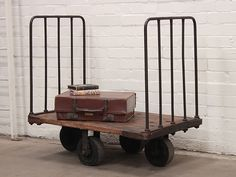Vintage Industrial Trolley   This is a great vintage industrial trolley, which we sourced from a local Scottish newspaper printing works.  This wood and metal press trolley would have been used for transporting the bound bundles of newspapers around the print room and warehouse.  Today this item would make an excellent visual feature for a domestic or retail environment.  http://www.scaramangashop.co.uk/at-home/vintage-furniture/vintage-shelving/vintage-industrial-trolley/prod_6410.html