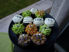 Monsters and mummies!  I made these for a mini Halloween party as a take home treat for the kids.  Pre decorating carnage.