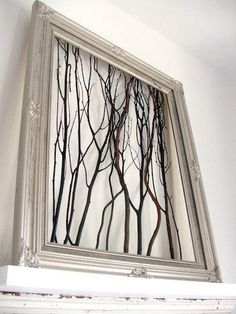 Branches inside an empty custom frame.  Hit Repin if you like this idea.:) #artframes #decorators