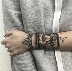 Right wrist area. Lavender, roses, orchids, mums, hollys, carnations, iris, marigold flowers.