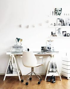 Simple. but effective. Black and white decor will help keep your mind clear as you work hard through the year. You can jazz it up with bold pen holders and photos.