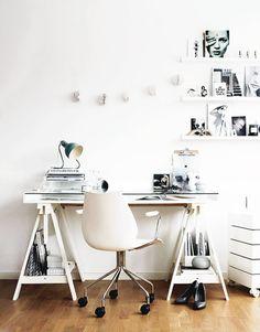 trestle desk + rolling storage + art work on ledges