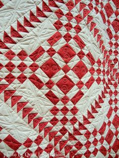 It's a Red Letter Day by Jacquelyn Thompson (Utah), quilted by Kim Peterson.  Pattern by ThimbleCreek quilt shop. Closeup photo by Quilt Inspiration.  2015 Springville (Utah) quilt show.