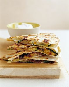 Fold garlicky sauteed zucchini, corn, cilantro, and grated pepper Jack cheese into flour tortillas and bake until browned and crisp. These quesadillas are also wonderful with the addition of black beans or soy chorizo.