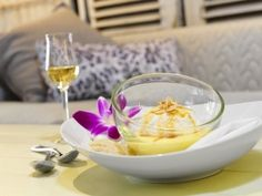 Pastry Chef Karine Moulin prepares a heavenly Ile Flottante as one of the divine desserts featured at Yellow Door Bistro. Wild Mushrooms, Stuffed Mushrooms, Duck Confit, Yellow Doors, Poached Eggs, Served Up, Culinary Arts, Macaroons, Punch Bowls