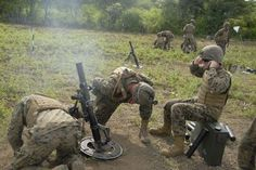 U.S. Marines fire an 81-mm mortar round at Camp Karang Tekok here, March 16. Marines with 2nd Battalion, 4th Marines