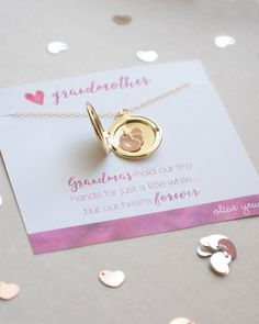 """Grandmother Locket Necklace includes up to 12 tiny initialed hearts - one for each grandchild! Thoughtful craftsmanship provides a 26 inch chain for easy over the head slip on & off - and a comfort clasp that's a """"snap"""" to use!"""
