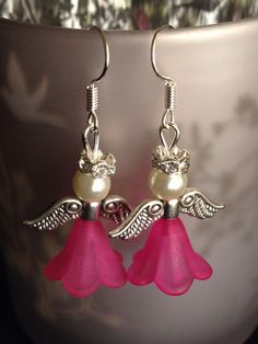 Hot pink angel Christmas earrings
