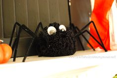 super cute t-shirt pom pom spider!! use an old black shirt to make one. #halloween