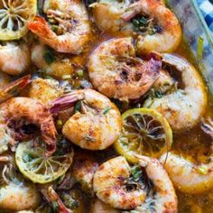 These New Orleans-Style BBQ Shrimp are so buttery, spicy, and good. Fresh shrimp are baked in a sauce flavored with lots of spice, garlic, lemon juice, and green onion.