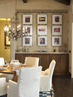 Simple Bungalow Extension Ideas and Designs : Rustic Dining Room For Bungalow Designs Also Lovely And Antique Chandelier Design Also Wooden Round Table And Dining Armchair With White Cover Also Brown Floorboards And Brown Cabinet And Adorable Picture Frame