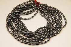 1strand  natural hematite plain rice sized 6 by 12mm by 3yes