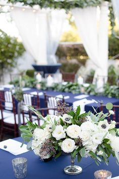 Lush white and green centerpiece with Anemones, Garden Roses, Ranunculus and Hydrangea. | by Gavita Flora #winter #wedding