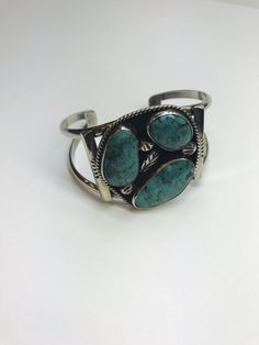"""Stunning Sterling silver wide cuff bracelet with three bezel set free form shaped natural turquoise.  Can be adjusted to fit up to 8"""" wrist.  weight is 42.9 grams   Shop this product here: http://spreesy.com/blingitaround/5   Shop all of our products at http://spreesy.com/blingitaround      Pinterest selling powered by Spreesy.com"""