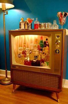 Old console TV turned into mini bar.
